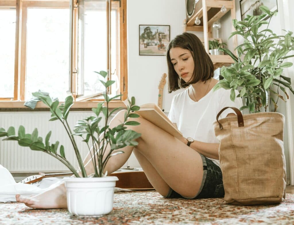 Girl sitting down reading a book