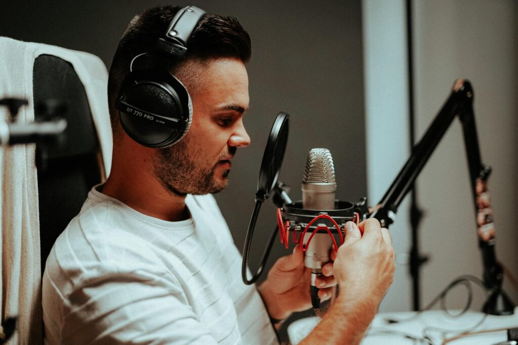 Malte Helmhold, a content marketer preparing to create content in front of a professional podcaster microphone