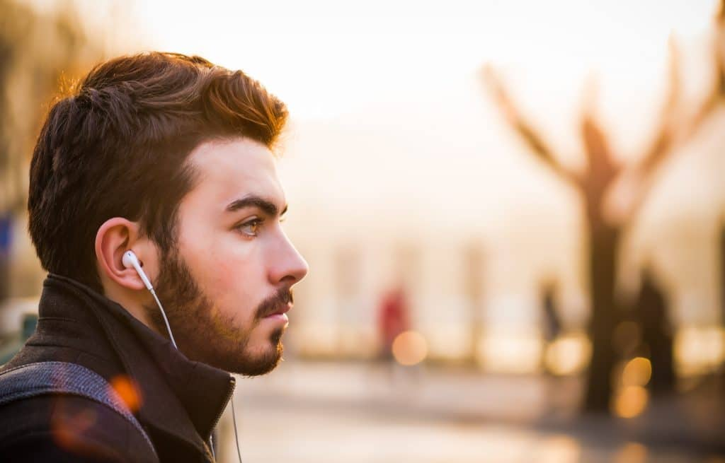 Man looking out listening to music