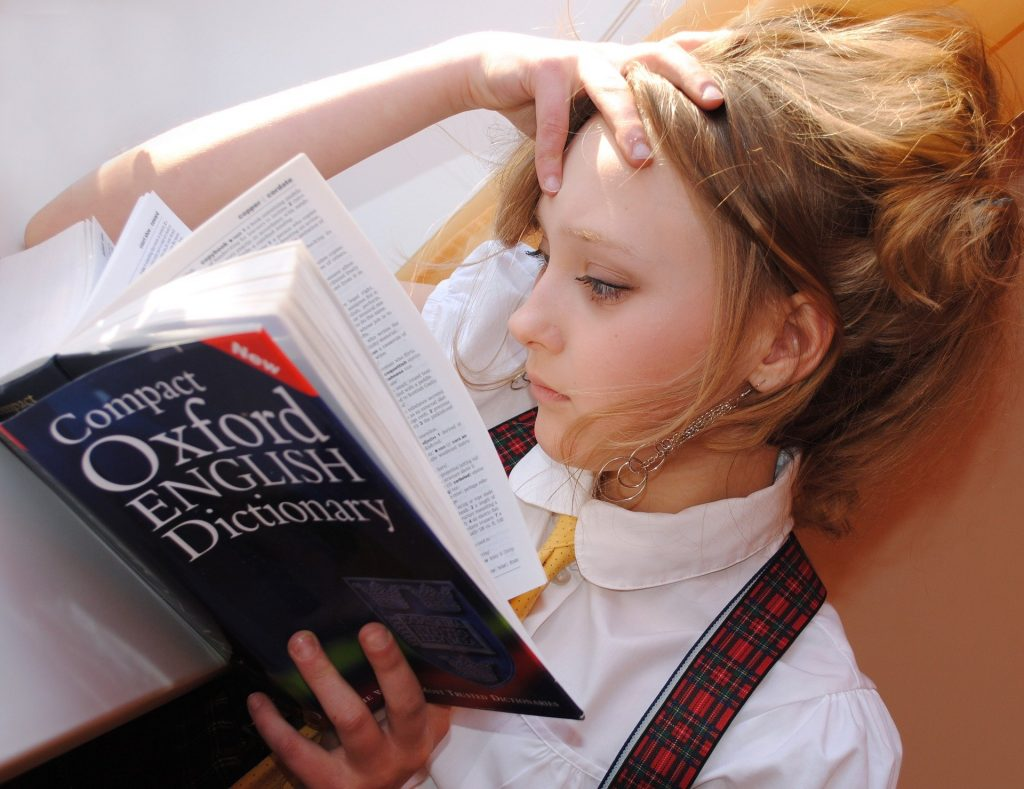 Girl reading the oxford English dictionary