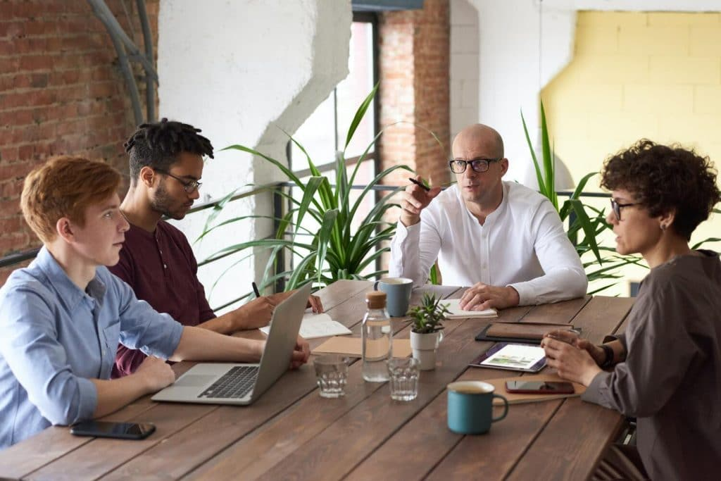 A group of people planning around a table